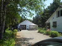 country Home with double workshop garage & 3+ acres
