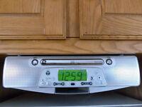 Radio AM/FM et lecteur de CD (installation sous l'armoire)