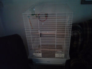 Large square  Hagen bird cage with stand to trade.
