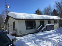 Roof snow removal by Grizzly Construction