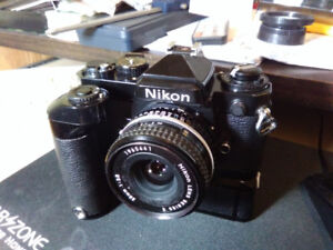 NIKON FE CAMERA WITH LENS AND MD 12 MOTOR DRIVE