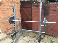 Weights rack with Olympic barbell