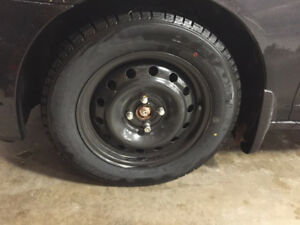 1 set of 185/65R15 Winter tires with steel rims