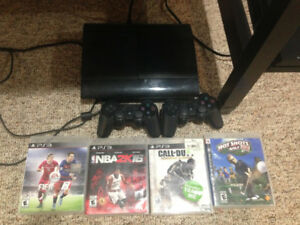 PS3 with 4 games and 2 controllers