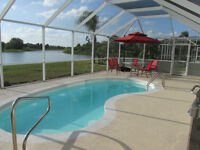 Gorgeous Gulf coast home w/ pool and on a lake.  Wow!