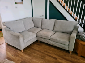 Light grey fabric corner couch and matching chair