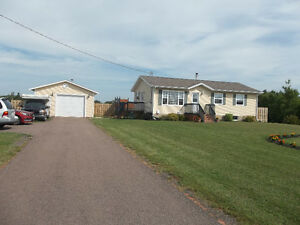 Newer bungalow with large detached garage .