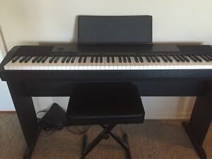 Electronic piano + bench for sale