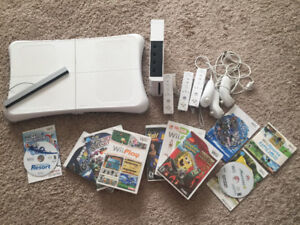 Wii Console, Wii fit board, and multiple games