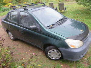 2003 Toyota Echo 4DR + 4 winter tires on rims, AS IS, NEEDS WORK