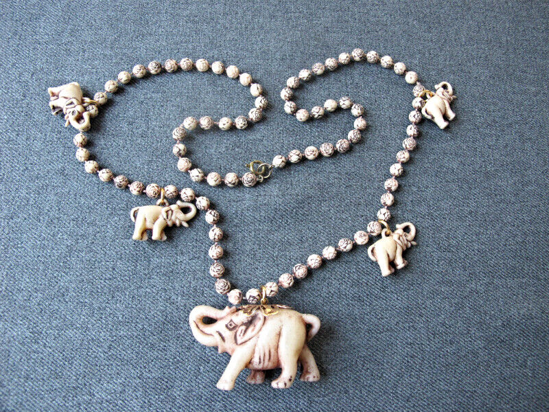 Vintage elephant dangles flower shaped beads brownish creamy plastic necklace