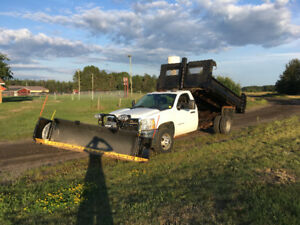 6.6 Duramax diesel dump truck and plow.