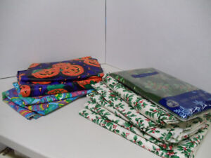 10  HOLIDAY FLANNEL-BACKED VINYL TABLECLOTHS - $10