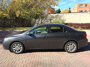 2010 Toyota Corolla LE with sun roof, snow tires, keyless entry