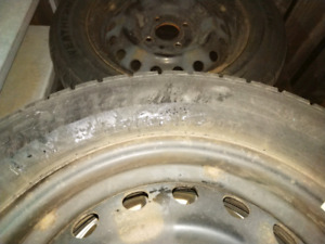 2 used winter tires on rims for nissan 205/60R15