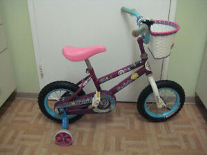 Girl's bike 12 size (for 3-4 yr old) with training wheels