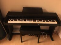 Full size electric piano - Roland KR-3000 digital keyboard