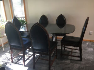 Retro smoked glass and chrome dining table with goth chairs