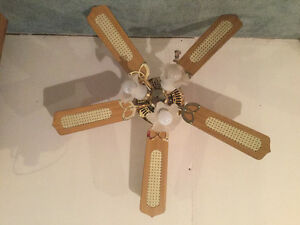 5 fan 3 speeds and reverse with 3 lights. Brass.