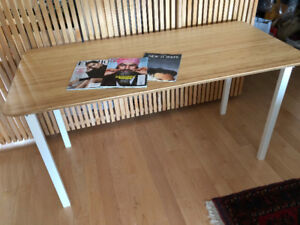 Almost - new, thin IKEA table for sale.