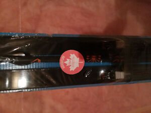 Brand new ski board/poles with package