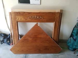 Oak veneer corner fireplace mantle