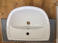 Semi recessed sink, tap and waste