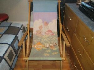 antique lounging chair with orange crush advertising