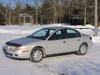 2001 Saturn SL1 with 2 sets of tires.