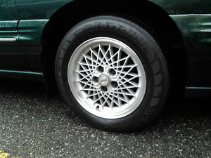 Set of four 225 60 16 summer tires on GM rims, 40$ per rim