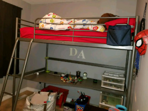 Bunk bed with desk below