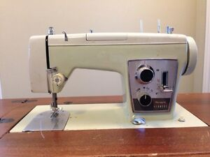 Vintage Sears Kenmore Heavy Duty Sewing Machine with cabinet