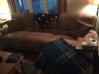 Plush couch with attached ottoman