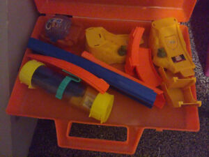 Lot of kid's race track toys with storage container bin