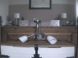 hanging ceiling light with three white lamp shades