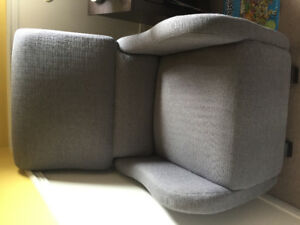 Grey nursery glider chair for mom and baby , artwork