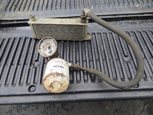MGB: used 13 Row Oil Cooler with one hose and oil  filter mount.