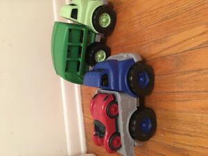 Green Toys brand recycling truck and flatbed truck with race car