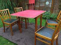 Retro red Formica drop leaf table with 4 retro chairs