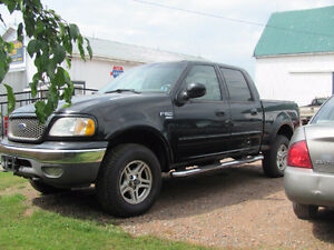 2002 Ford F150 Lariat, 4 door, 4x4, loaded with leather.