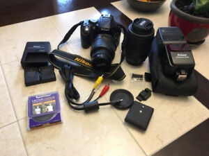 Nikon D5200- plus 2  lenses, flash, and an extra battery