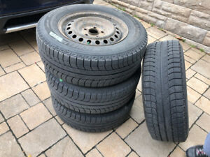 Winter tires with rims included  235/65/R16