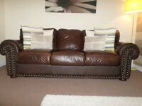 3 Piece dark brown leather suite and sideboard
