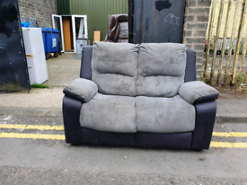 16. Grey and black 2 seater sofa
