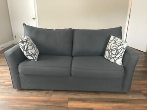 Grey Sofa Bed with Pillows