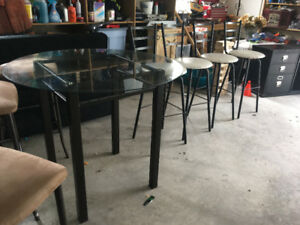 Glass top dining table with 4 stools
