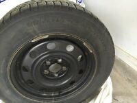 Set of 4 BF Goodrich Winter Tires and Rims