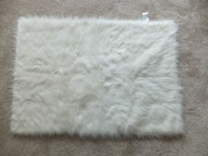 """FOR SALE 5 New White quilted blankets 45""""x30"""" - $15.00 each. Cal"""