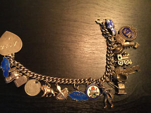 Antique sterling silver charm bracelet with 20 charms