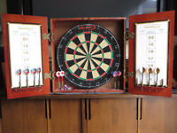 Halex dart board in cabinet with darts